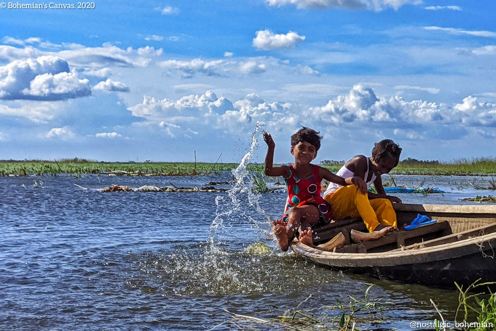 Photo in Rural #children #childhood #ecstasy #countryside #lake #shaonmrnobody #bohemianscanvas #bohemianphotographer #photographerofbangladesh #nostalgicbohemian #brightday #splash #boatyard #lateautumn