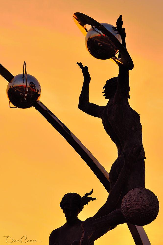 Photo in Cityscape #madrid #statue #silhouettes #orange #black #goldenhour #street #sunset