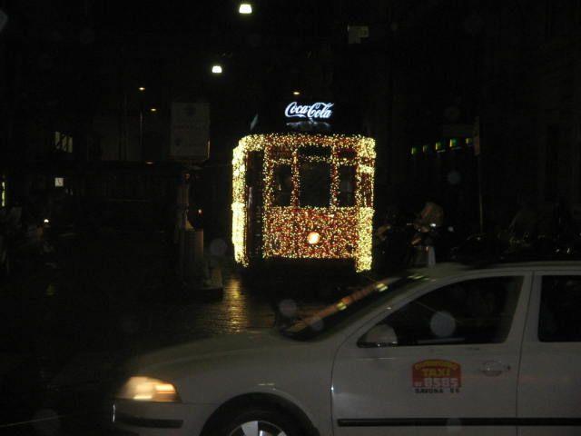 Photo in Street Photography #milan #milano #tram #christmas milano #christmas milan #light on tram #coca cola #night lights #italy tram #italy #night #transportation #advertise