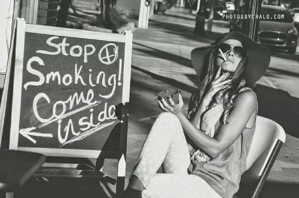 Photo in Street Photography #smoke #smoking #beauty #stop #street #sign #black #white #artist
