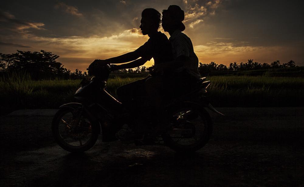 Photo in Travel #scooter #sunset #rice #bali #travel #people #balinesian #road #bike #ride
