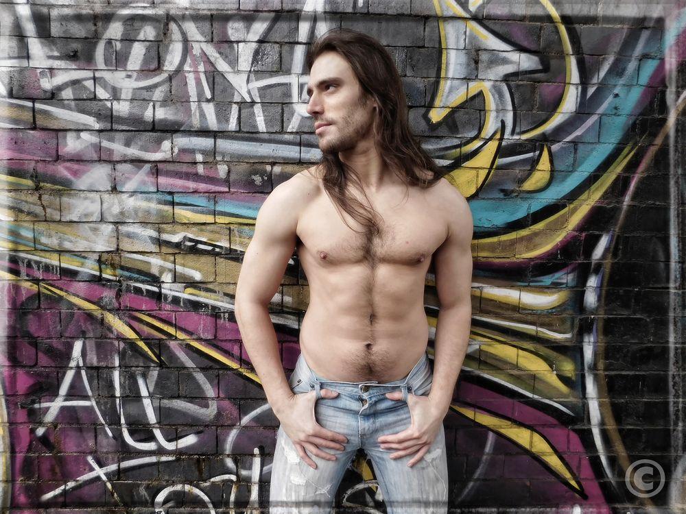 Photo in Random with model Iain  #male model #bare chest #graffiti #location