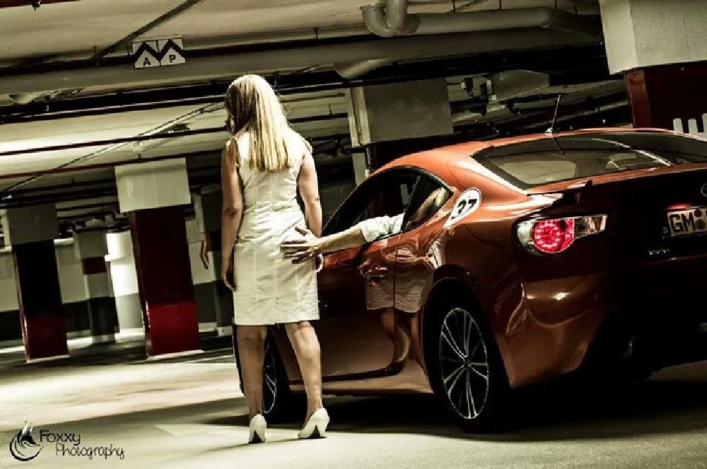 Photo in People #perky #bold #man #woman #car #toyota #gt 86 #orange #white #park #parking lot #garage