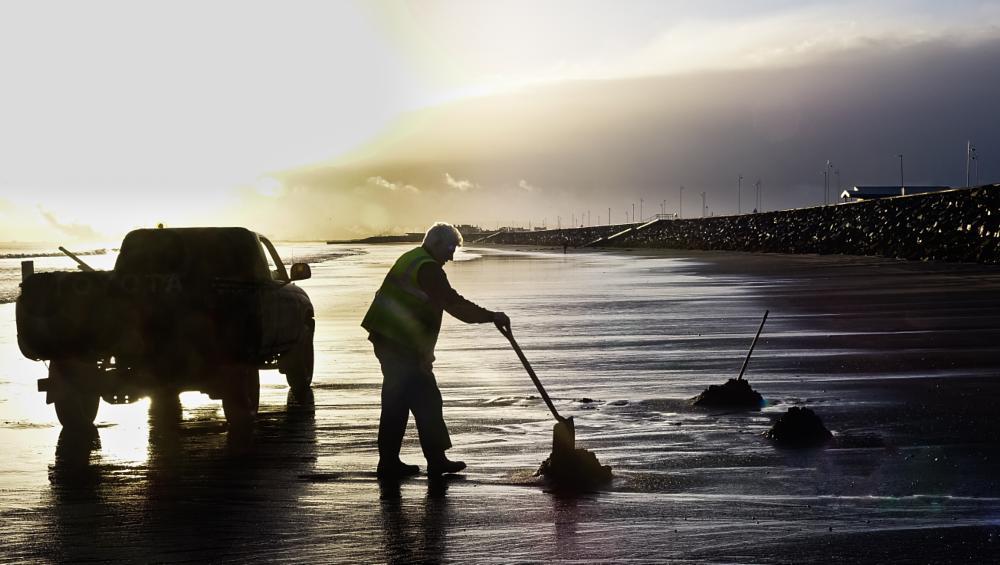 Photo in People #beach coal cold winter hard wo