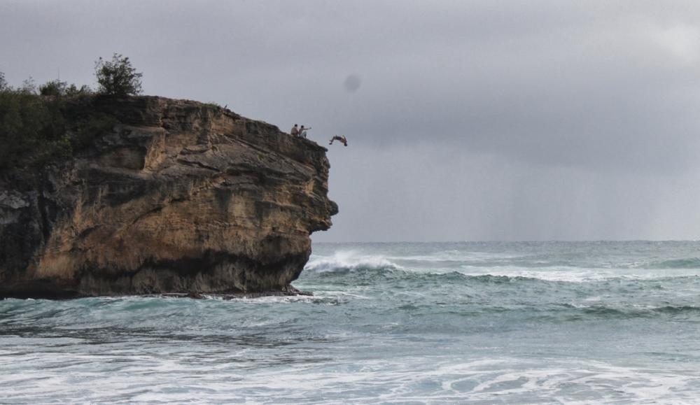 Photo in Landscape #cliff jumping #diving #beach #poipu #shipwreck beach #kauai #hawaii