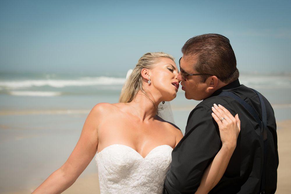 Photo in Wedding #wedding photographers #beach #kiss #love #nikon #passion #bride #groom #bridal couple