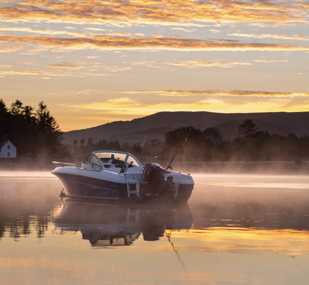 Photo in Sea and Sand #boat #fishing #speedboat #bay #morning #sunrise #sea #reflection #clouds #trees #mountains #photography #youpic #ireland