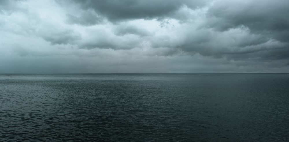 Photo in Nature #water #sea #clouds #ocean #desert #horizon #line #rain #dark