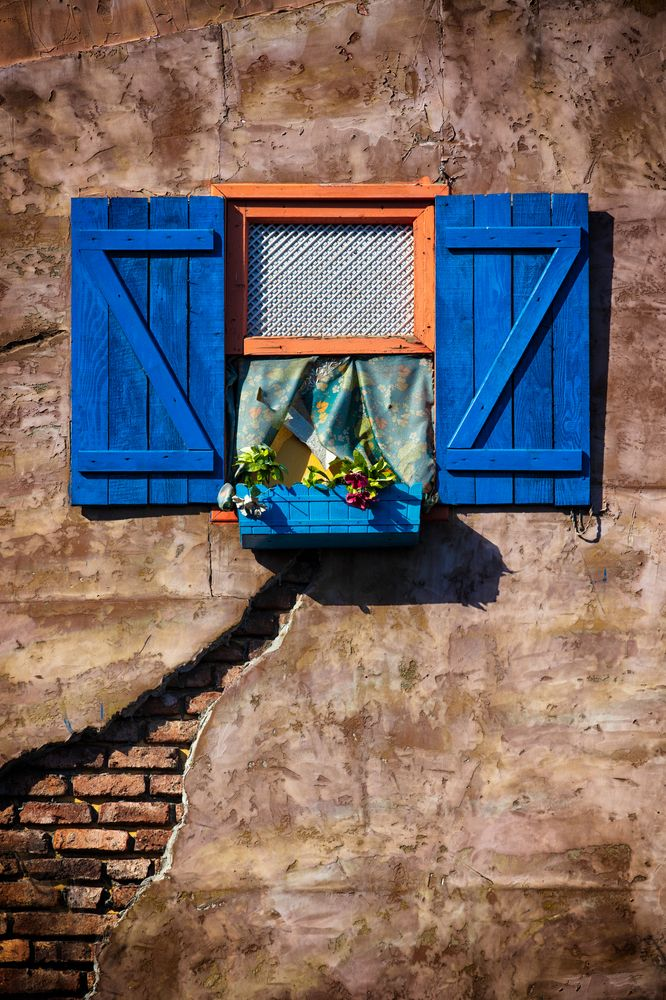 Photo in Random #travel #istanbul #turkey #window #bricks #plaster #cracks #flowers #blue #orange