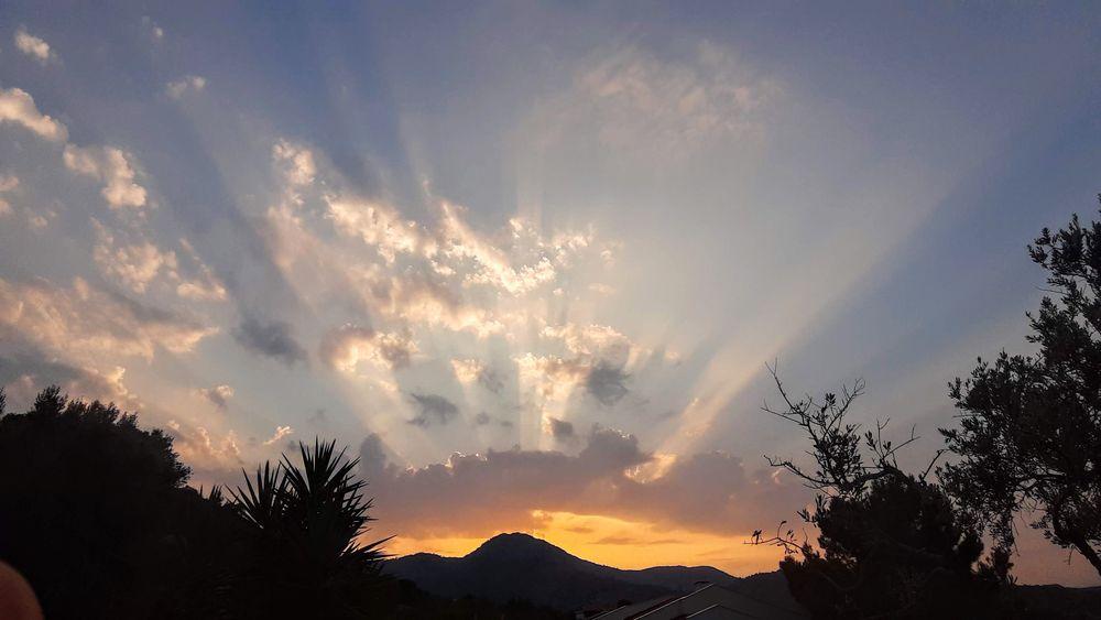 Photo in Random #sky #cloud #sunlight #morning sun #rays of sunlight #trees #landscape