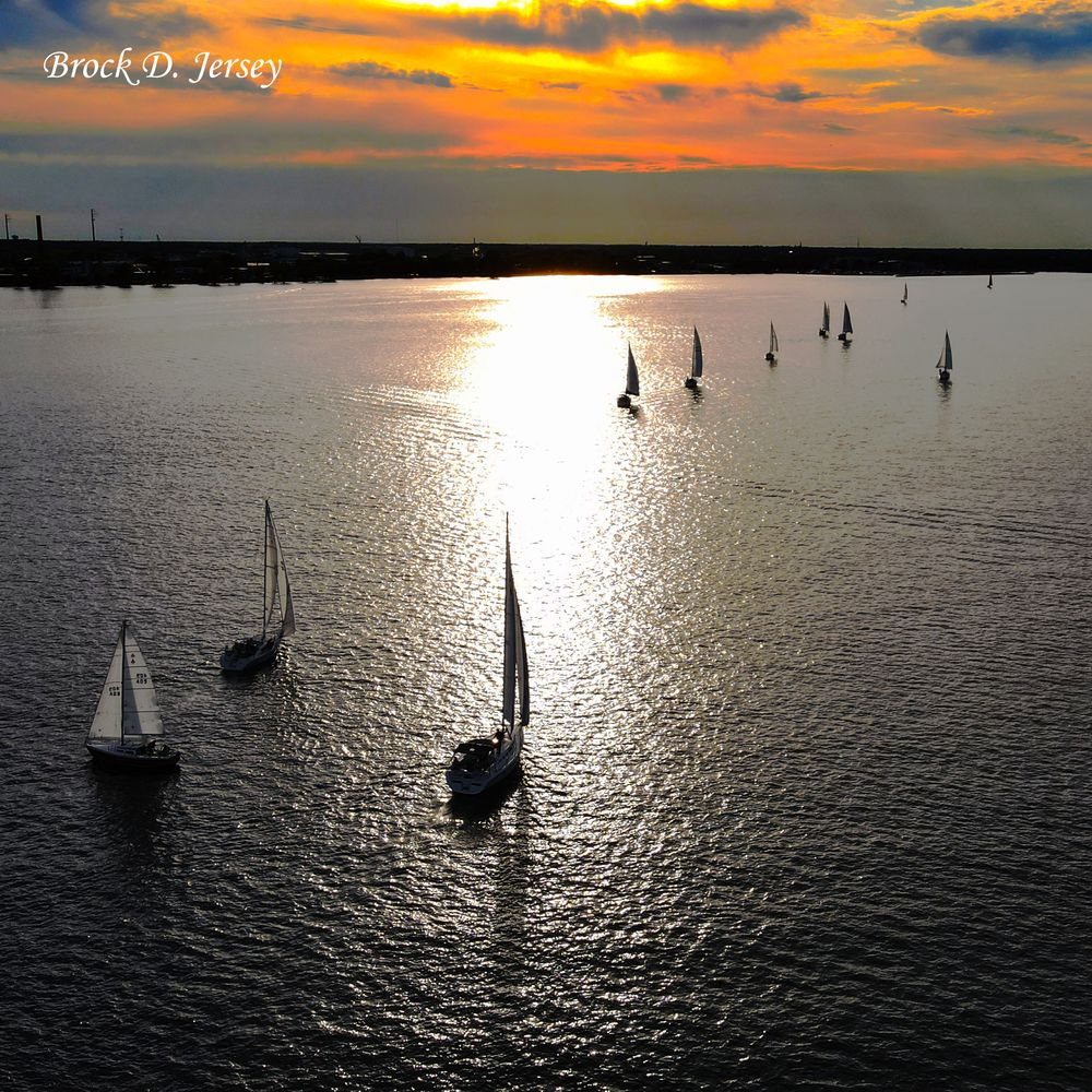 Photo in Aerial #single #drone #sailboat #lake #sunset #aerial #nature #beauty