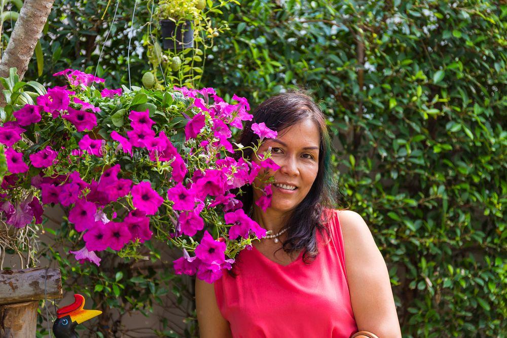 Photo in People #beauty #portrait #fashion #red #garden #flowers