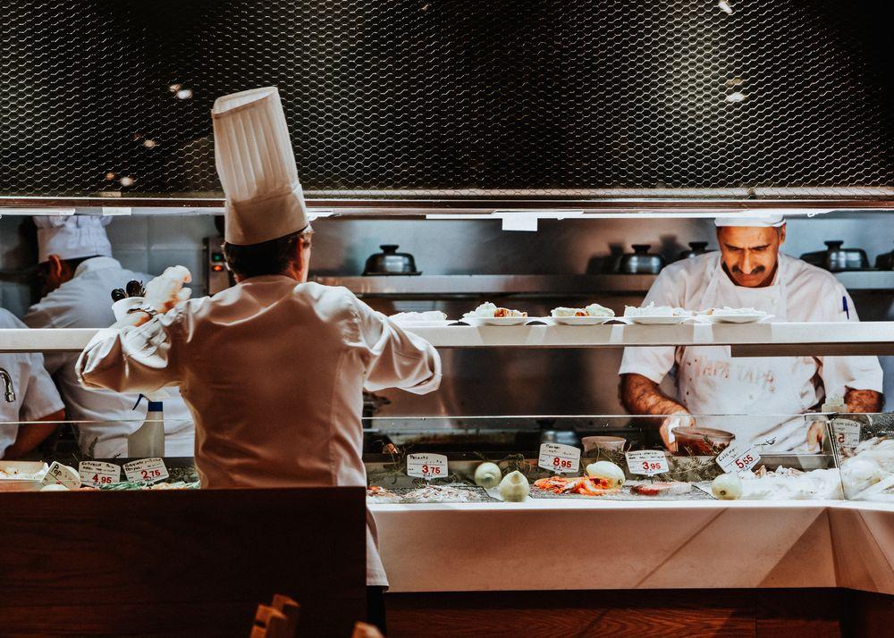 Photo in Street Photography #spain #madrid #tapa tapa #tapa's #cooks #kitchen #service #preparing #street photography