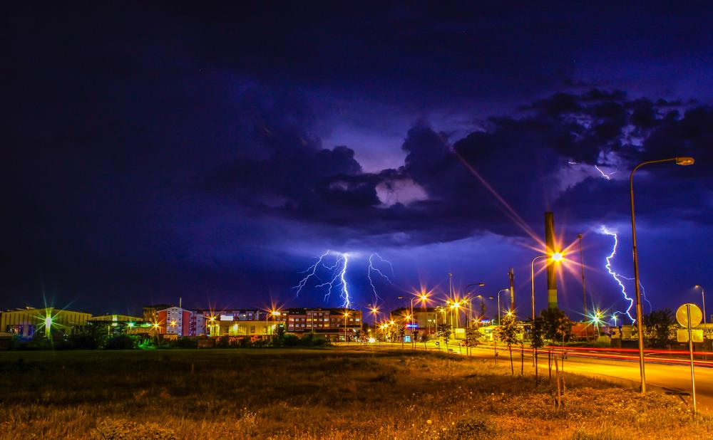 Photo in Landscape #storm #two #hits #thunder #lightning #city #landscape #weather #weatherscape #grass #road #lights #light