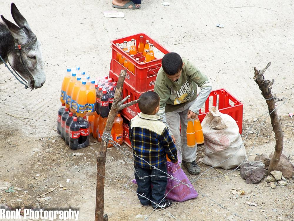 Photo in Street Photography #children #donkey #working #morocco