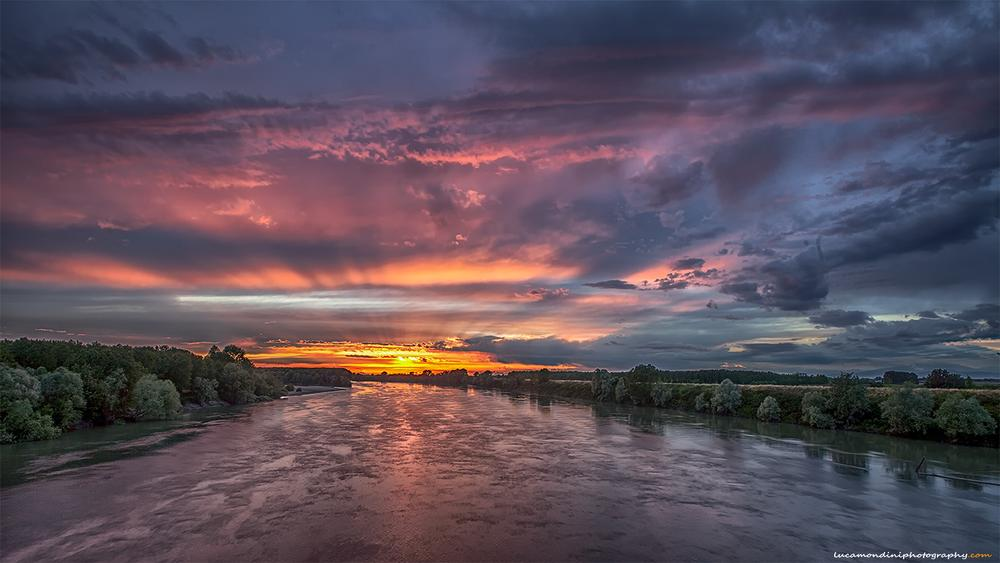Photo in Landscape #sunset #clouds #river #sun #down #italy #water #cloudy sunset #po river