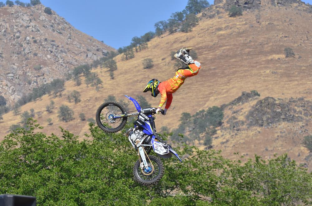 Photo in Sports #flying cowboys #fmx motorcycle jumpers #soaring sky high #tricks #not for faint of heart #teenagers