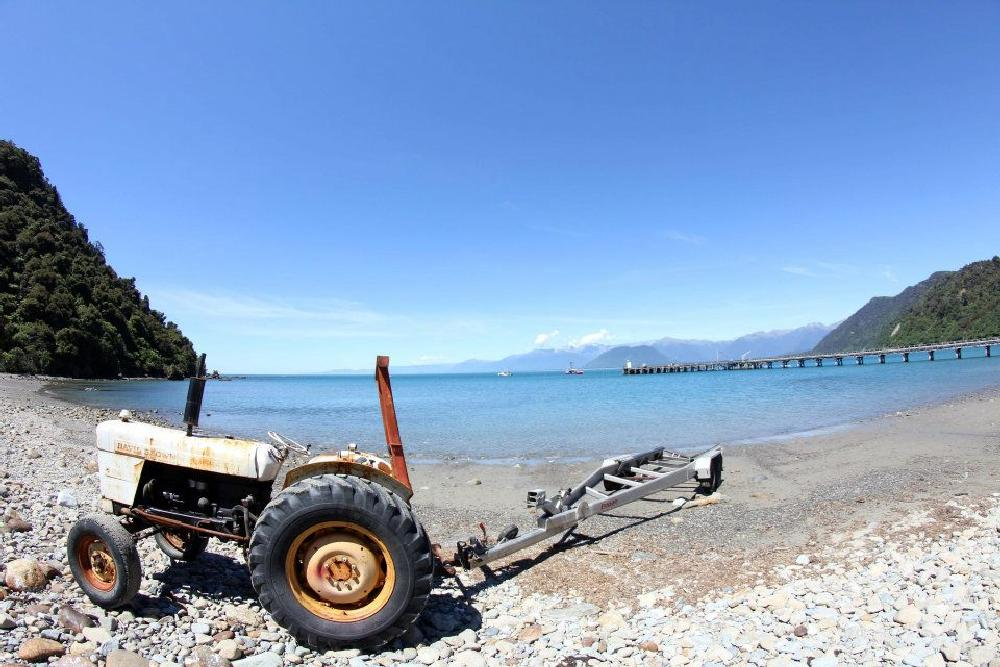 Photo in Landscape #beach #ocean #tractor #jetty #fishing #nature #new zealand
