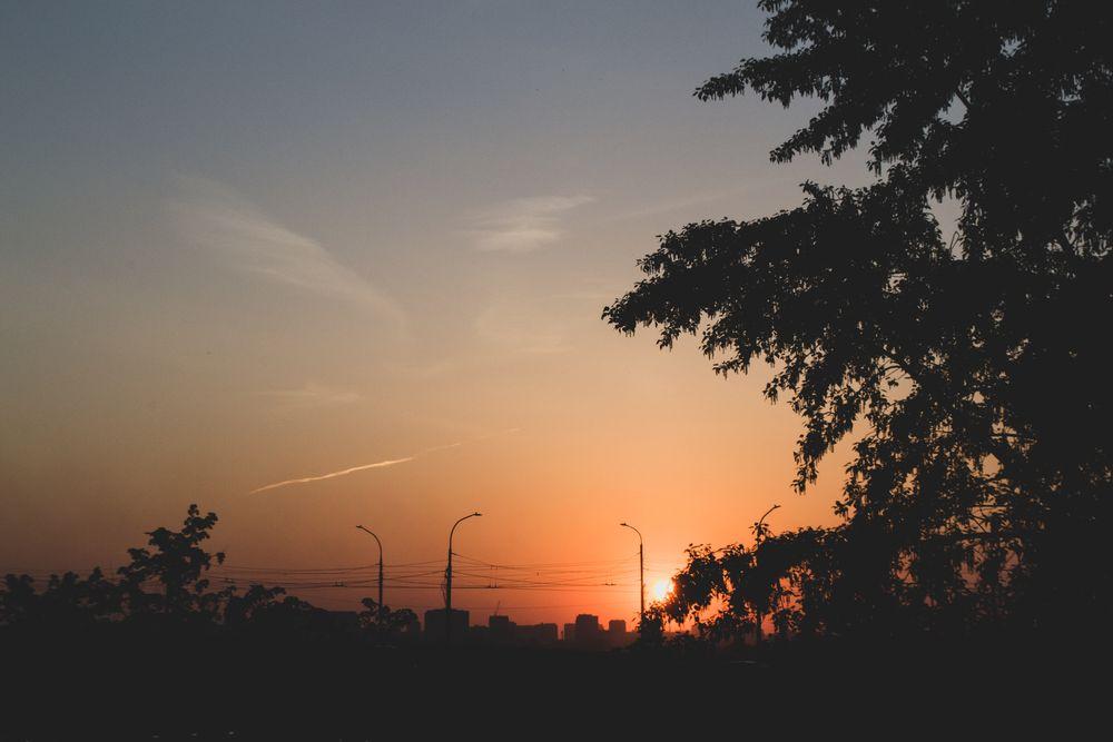 Photo in Cityscape #city #cityscape #sunset #sun #sky #trees #streetlights #clouds #blue #red #orange #evening #street #nikon #russia #siberia #sunshine #view #distance