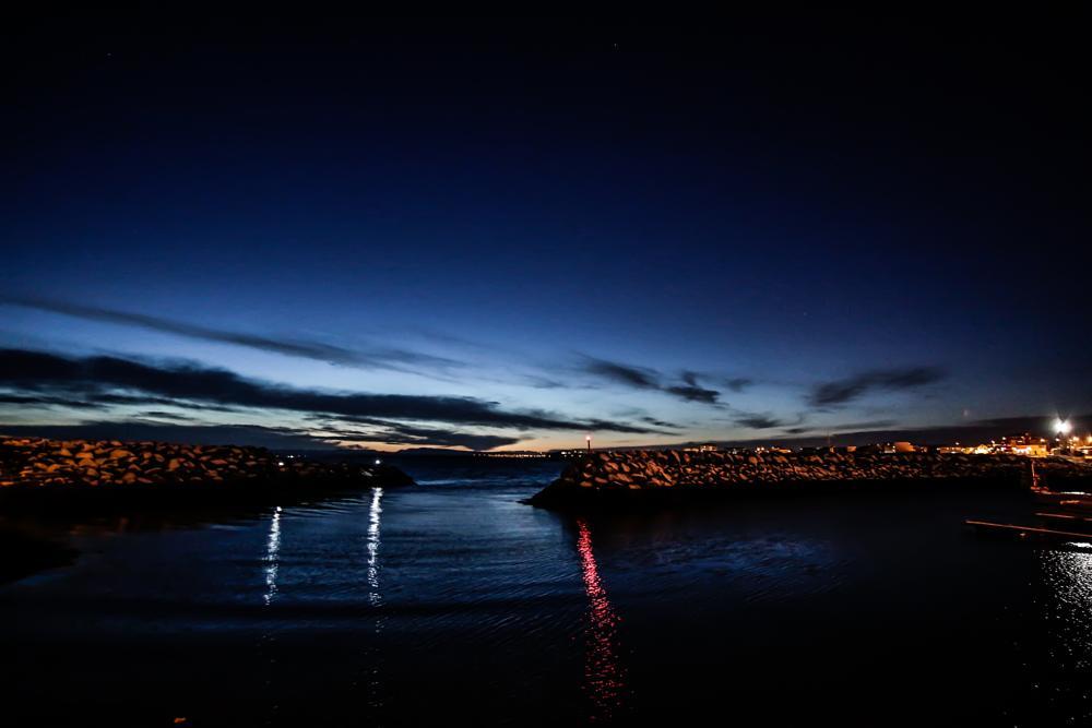 Photo in Landscape #keflavík #harbor #iceland #reykjanes #reykjanes peninsula #ocean #faxaflói #rocks #water #blue #light #red #sky #stars #sun #sunrise #waves #boat #boats #houses #lighthouse #sunshine #yellow #orange #landscape #starscape #samyang 10mm #canon eos 650d #morning #early #rise #winter
