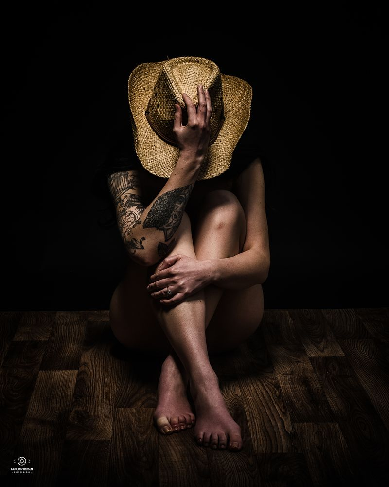 Photo in People #low key photography #art nude #hat #tattooed model #inked girls