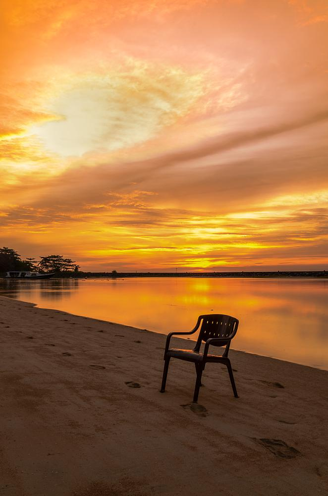 Photo in Landscape #beach #afternoon #chair #sunset #clouds #sky