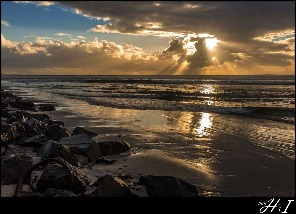 Photo in Random #sunset #rays #waves #stormy #grey #cold #winter #rocks #reflection