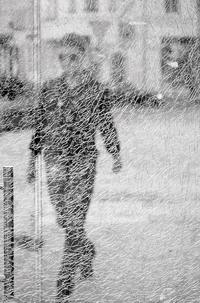 Photo in Street Photography #street #street photography #people in the street #b&w #black and white #glass #abstract #street shot #poland #nikon