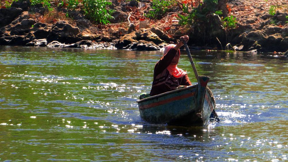 Photo in Rural #boats #grandma #river #old woman #transportation
