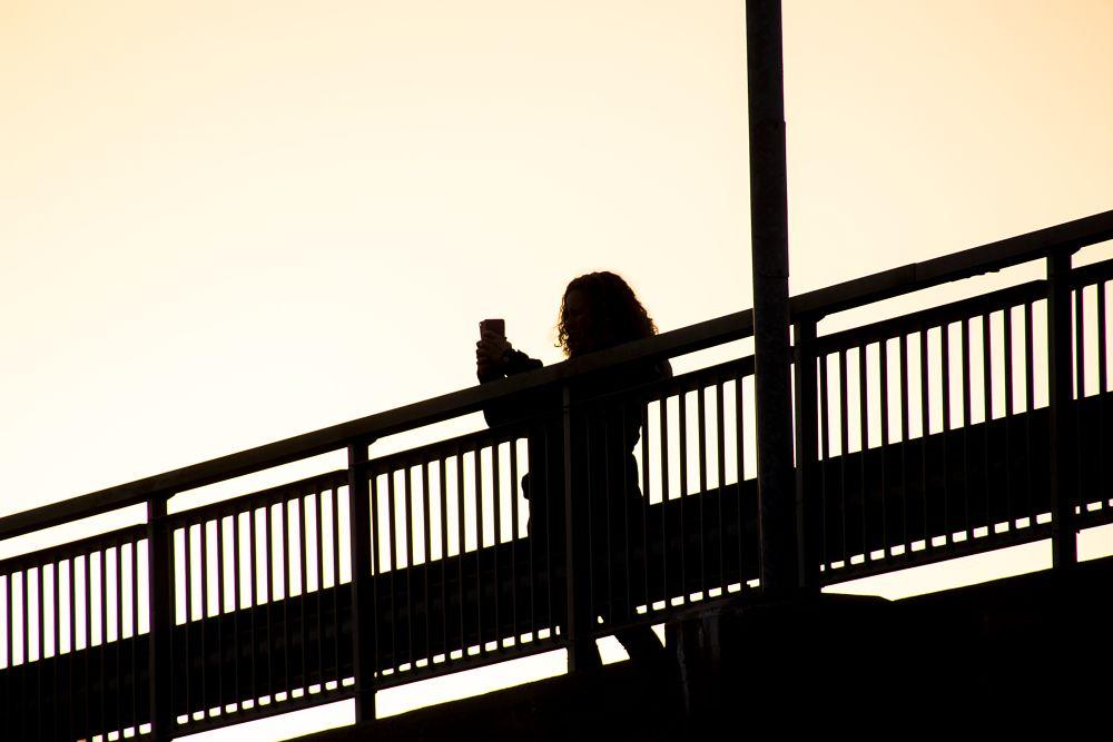 Photo in Street Photography #woman #sunset #bridge