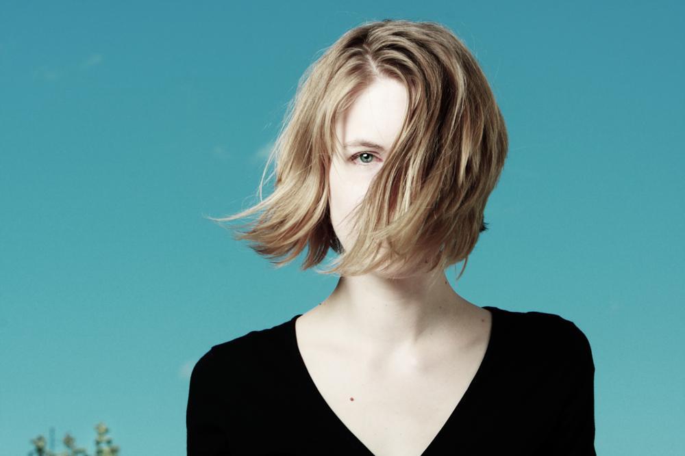 Photo in Portrait #woman #girl #wind #breeze #blond #portrait #studio #flash #blue #gezett
