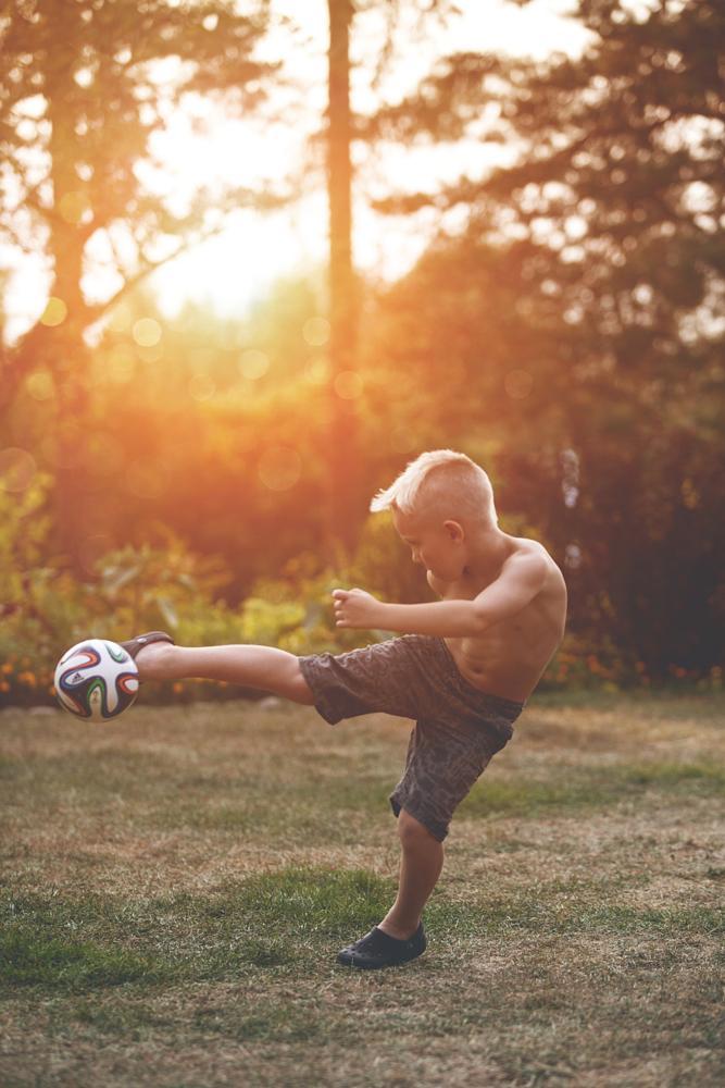 Photo in People #boy #fotball #summer #sunset #sport #outdoors #sun