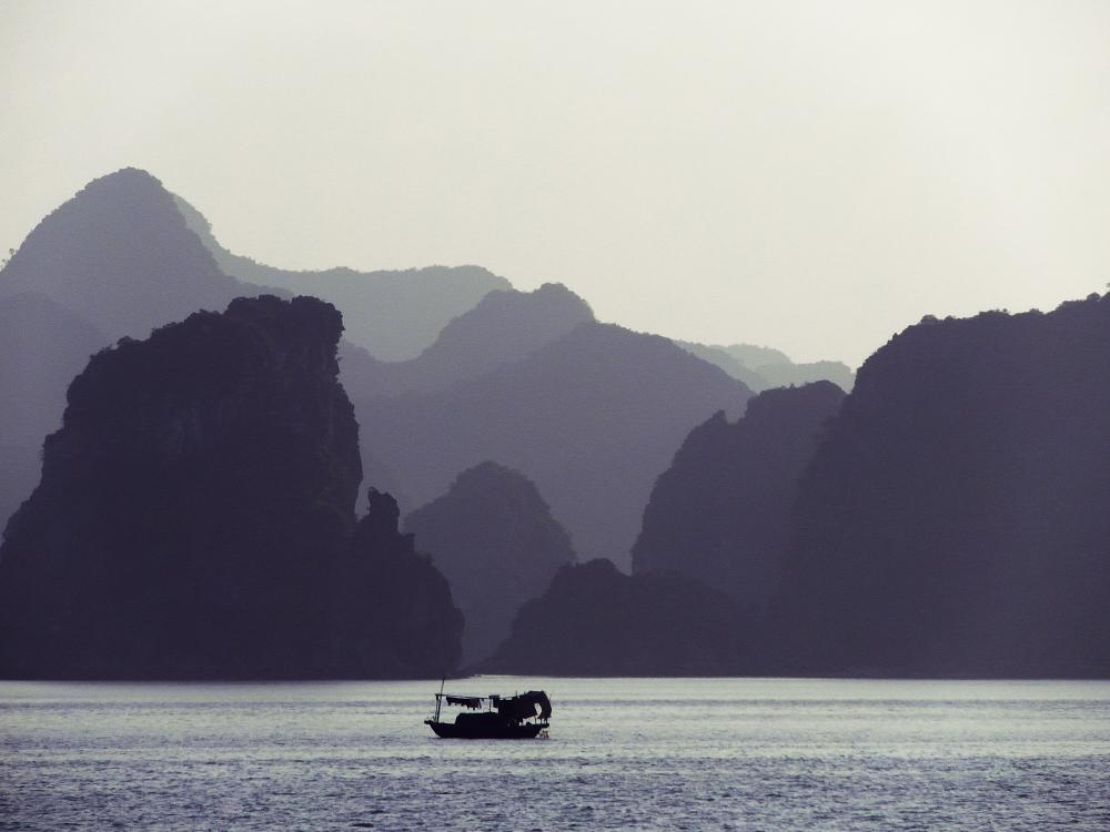 Photo in Travel #halong #bay #world #heritage #site #vietnam #travel #explore #monochrome #fishing boat #islets
