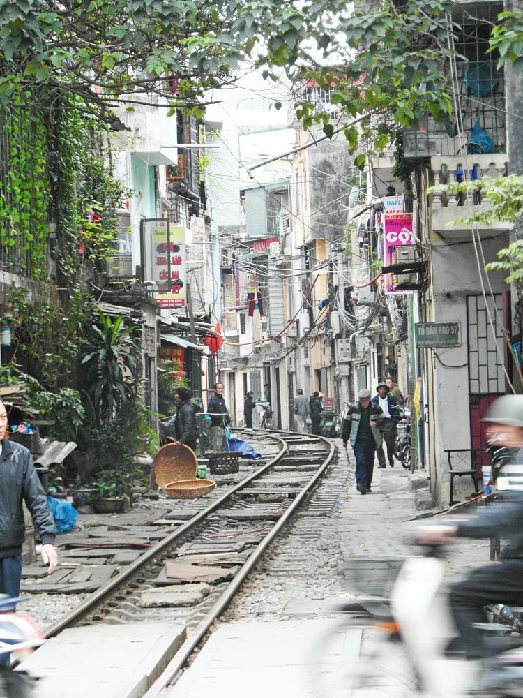 Photo in Street Photography #hanoi #backstreets #traintracks #railway #tracks #people #life #cables