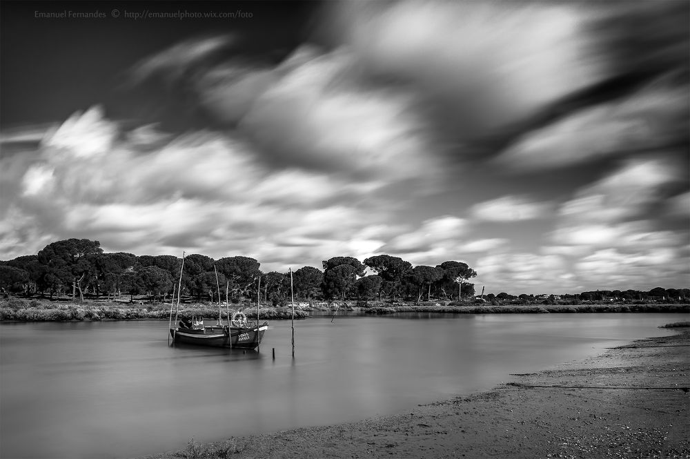 Photo in Landscape #clouds #black #white #boat #water #long #portugal
