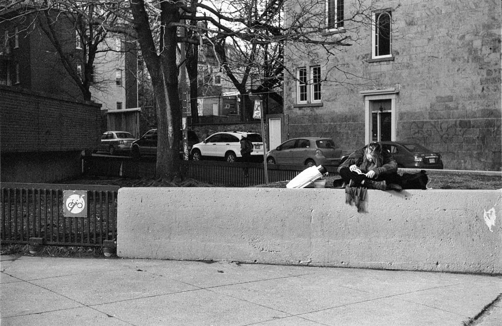 Photo in Black and White #black and white #street photography #analog #film #35mm #city #urban #portrait #reader #leica #montreal