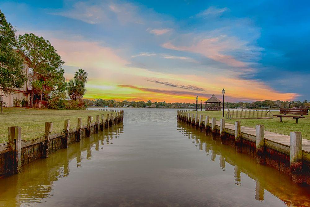 Photo in Landscape #boat ramp #canal #lake #sunrise #boardwalk #nature #dock