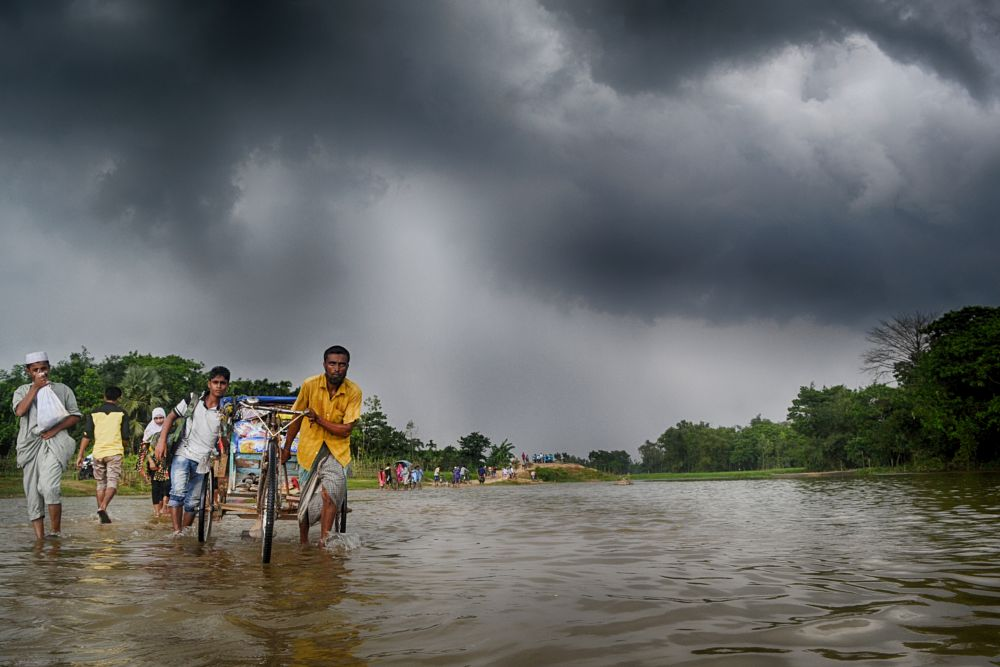 Photo in People #after the rain #rain #water #people #vehicle #lives #lifestyle #livelihood