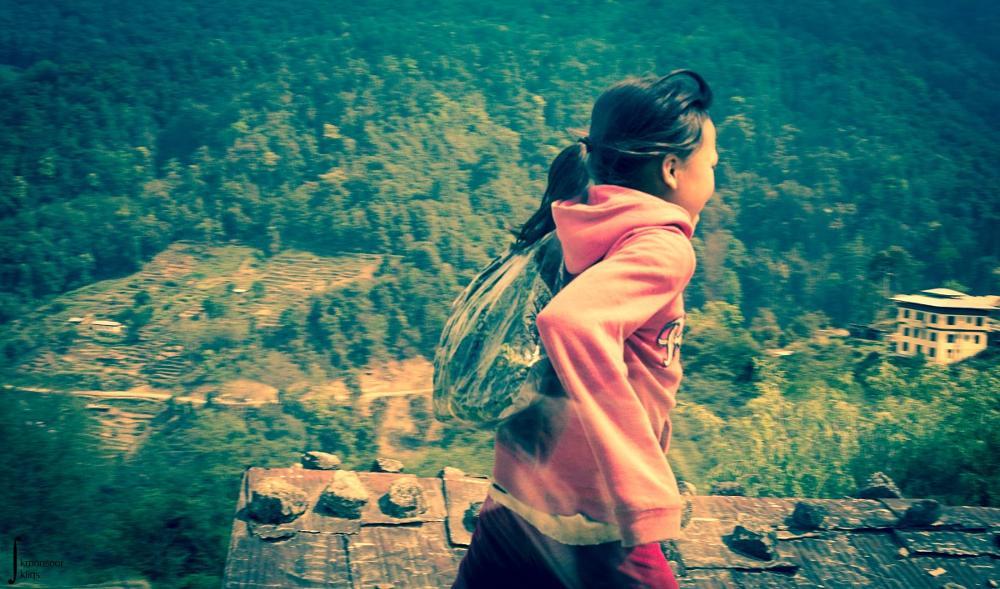 Photo in Travel #bhutan #running #kid #child #girl #mountain #hilly #roadside