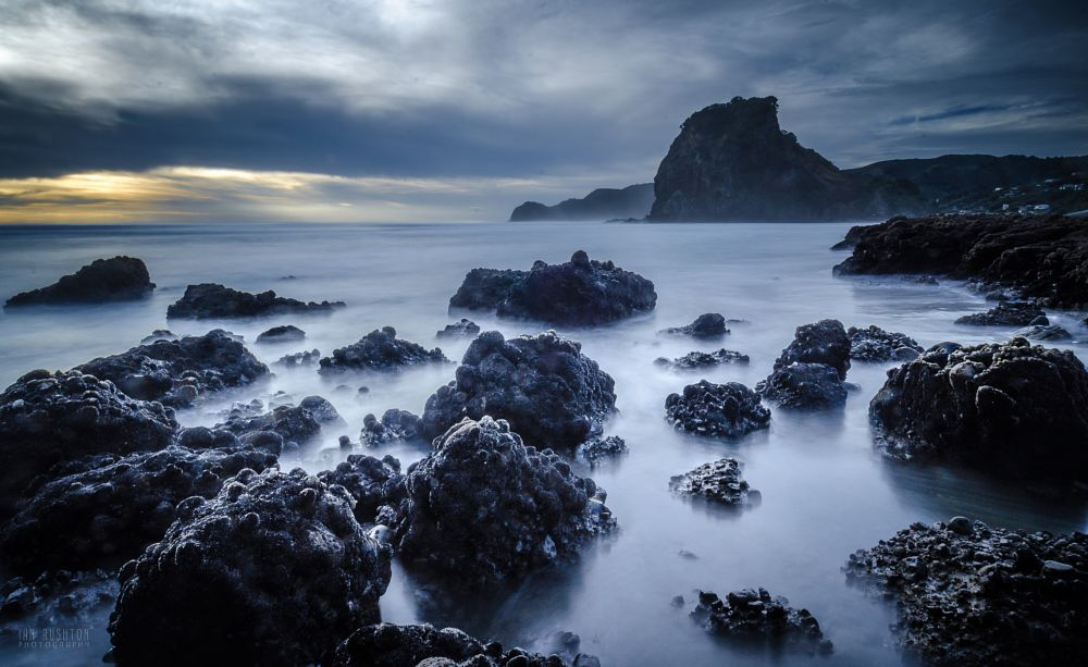 Photo in Landscape #piha #sea #surf #beach #long exposure #auckland #new zealand #rocks