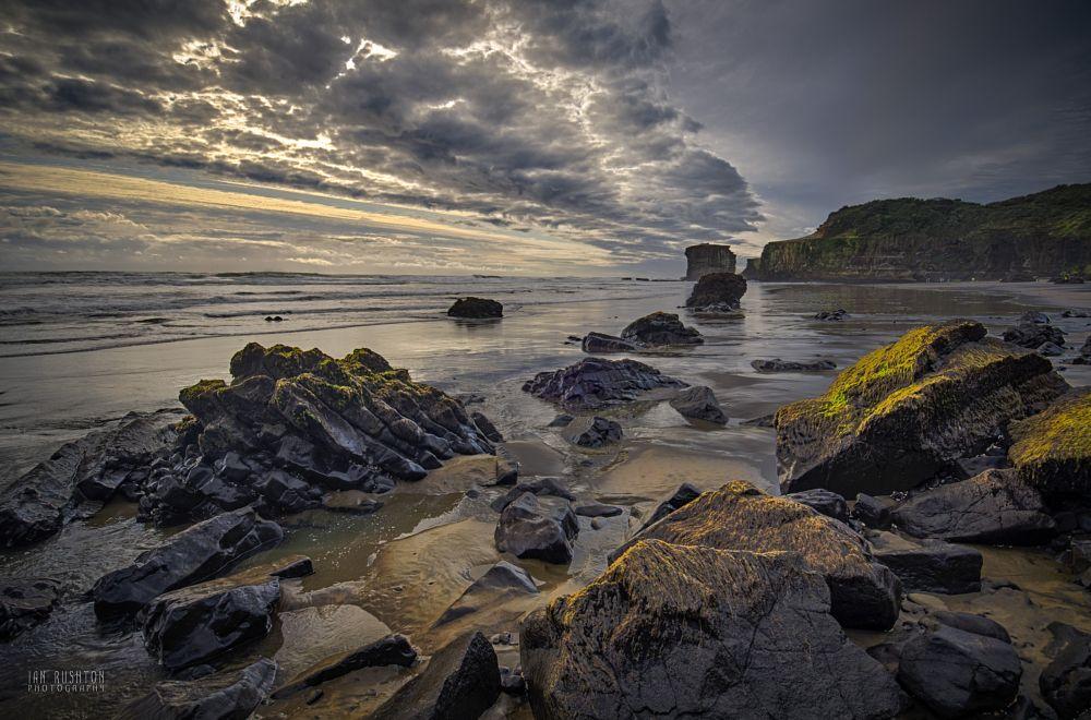 Photo in Landscape #beach #clouds #rocks #sand #auckland #new zealand #muriwai #maori bay