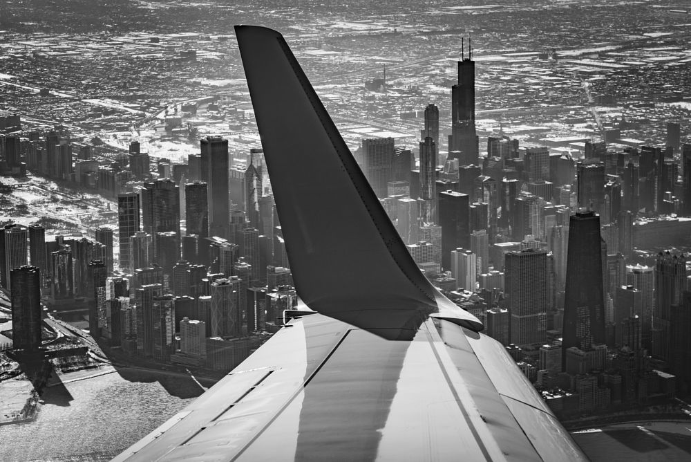 Photo in Cityscape #chicago #skyline #cityscape #black and white #airplane
