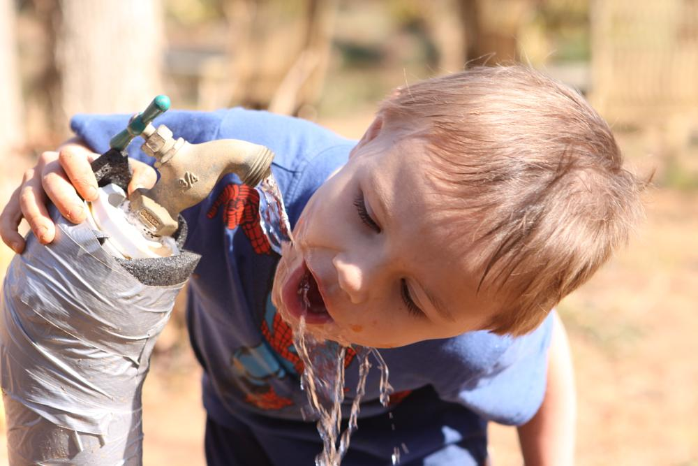 Photo in Journalism #drink #farm #boy #play