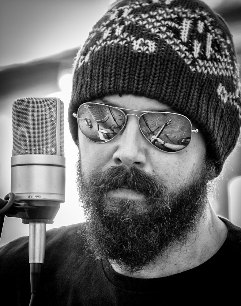 Photo in Street Photography #bw #black and white #sunglasses #man #microphone #beard #reflection