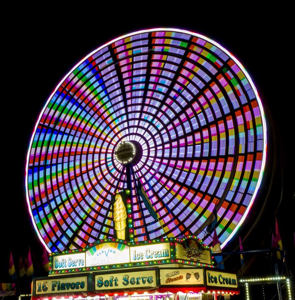 Photo in Abstract #carnival #festival #ferris #wheel #slow shutter #long exposure #night #nikon