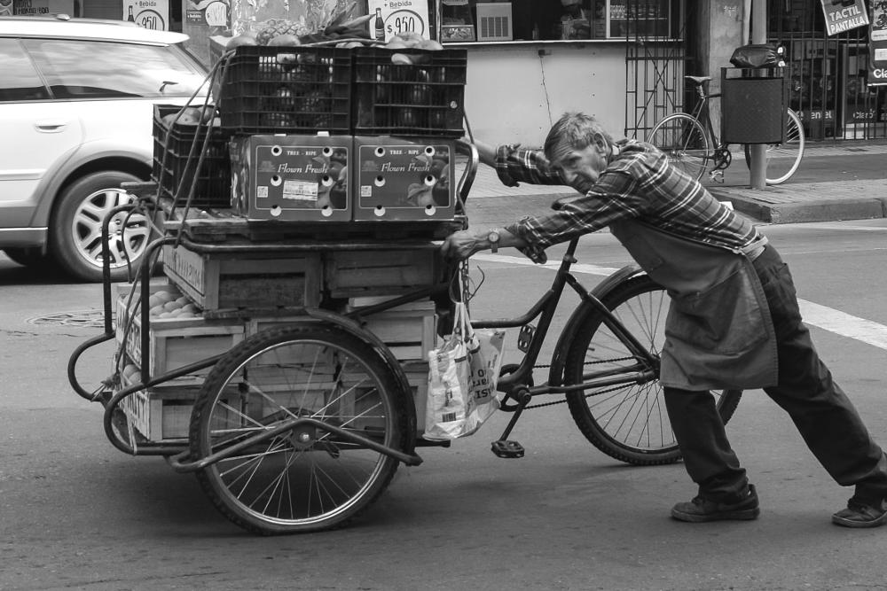 Photo in Street Photography #streetcontest #chile #santiago #old man #cart #fruit #vegtables #black & white #bike #street photography