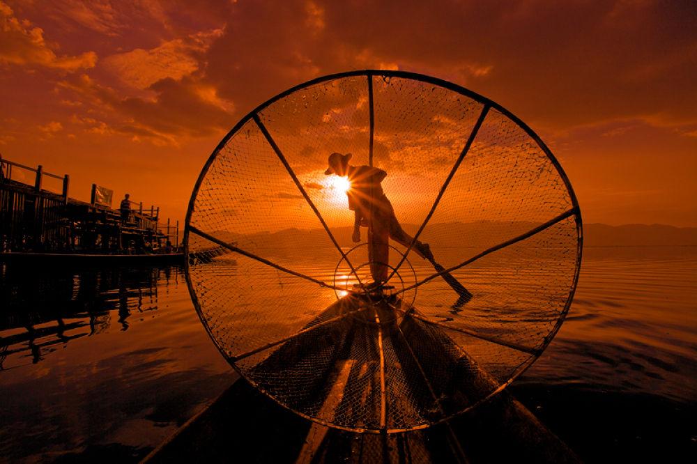Photo in Random #silhouette #sunset #sunrise #leg rowing #fisherman #wooden boat #burma #burmese #myanmar #inle lake #ypa2013