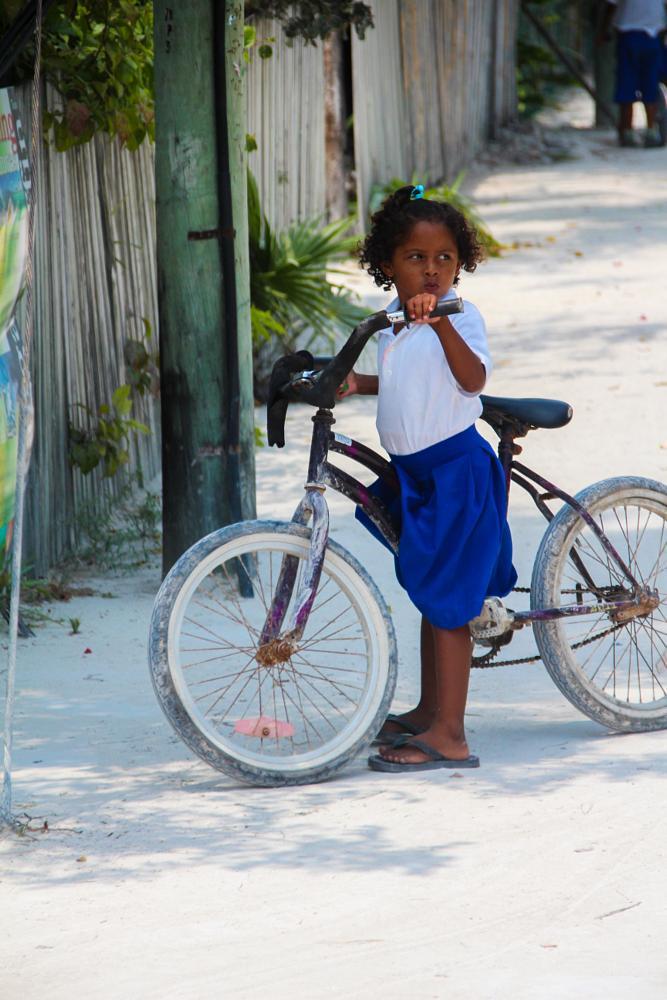 Photo in Street Photography #belize #caulker #caye caulker #cay caulker #bike #bicycle #schoolgirl #cute #girl #school #life
