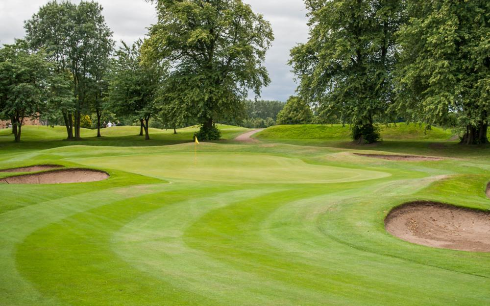 Photo in Sports #green #bunkers #sand #hole