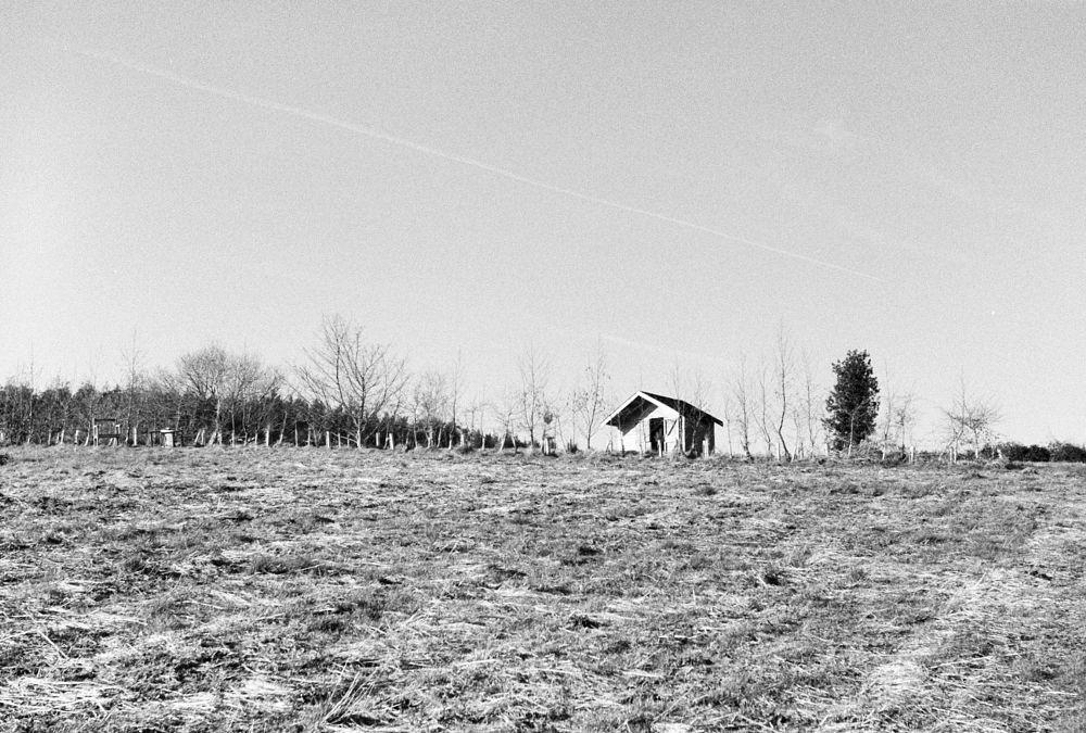 Photo in Black and White #field #cabin #devon